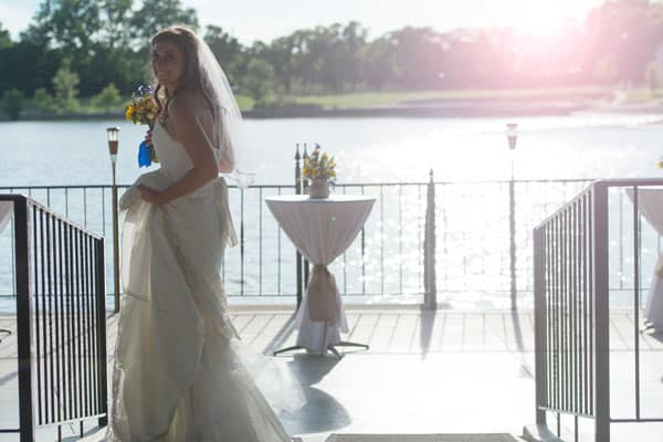 Bride Wedding Picture Standing with Sunlight behind her