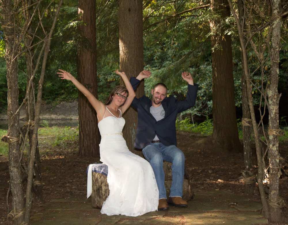 bride and groom waving arms