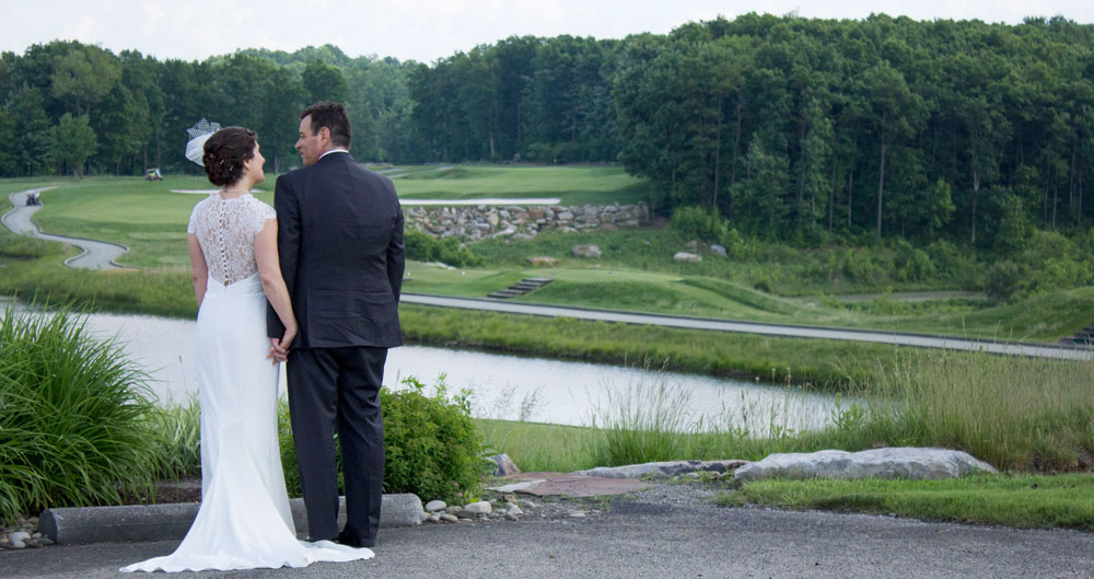 wedding photographer captures bride and groom looking out into the distance